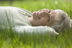 Carefree Woman Lying in the Grass