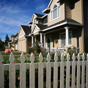 Picket Fence in Front of Houses
